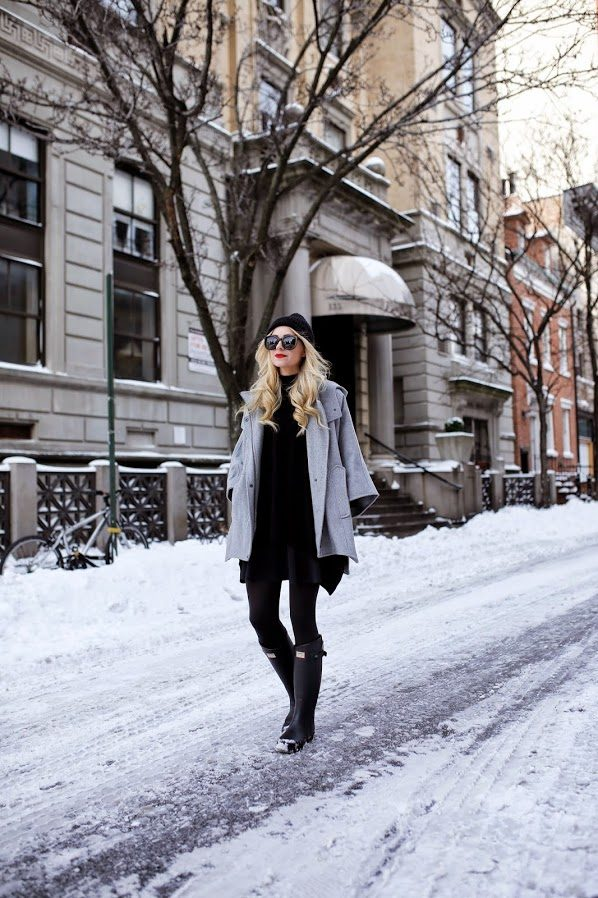 Blair Eadie takes on a snow day by layering up in black and grey tones. With its grip and durability, Hunter Boots are essential for snowmen making. Jacket: DKNY, Poncho: Theory, Skirt: Topshop, Boots: Hunter, Lips: Stila 'Beso', Sunglasses: Karen Walker 'Super Duper', Hat: Old