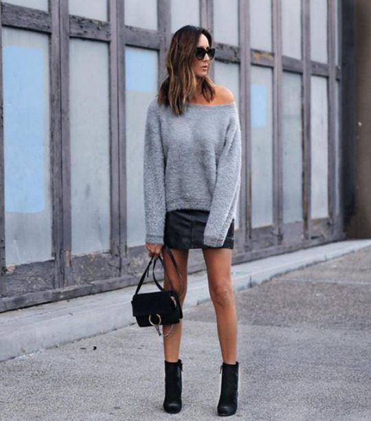 Stephanie Mooney shows us exactly how to wear the sweater and skirt combo here. Pair two similar pieces with striking ankle boots and a leather mini bag to steal Stephanie's glamorous style! Sweater: Elliatt, Shoes: M. Gemi.