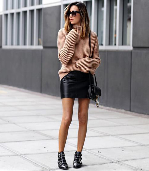Stephanie Mooney is rocking the sweater and skirt combo, creating a charmingly preppy style which we adore! Wear a similar look with leather buckled boots to steal the edgy touch Stephanie has created. Brands not specified.