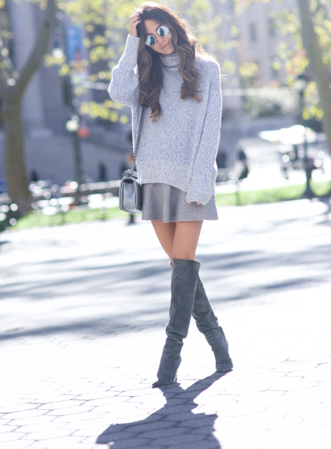 Arielle Nachami is gorgeous in grey, pairing a knitted sweater with a super cute mini skirt and thigh high boots for a sophisticated seasonal look! Wear this style with shades to capture the cool, casual vibes Arielle is rocking!   Sweater: Otte NY, Skirt: Zara, Boots: Barney's.
