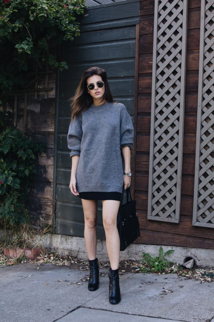 Try wearing an oversized knitted sweater with a mini skirt for a new twist on the trend! Jackie wears this look with black booties and a matching leather tote for a stylish monochrome aesthetic!   Sweater: Zara, Skirt: Aritzia, Boots: Rebecca Minkoff.