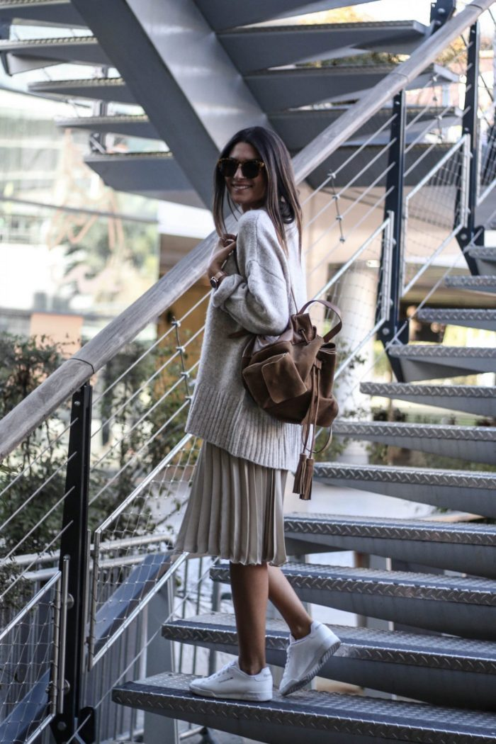 Federica L. has created a seriously cute fall style here in a knitted sweater and pleated skirt. Wear this look with plain sneakers to capture these casual, seasonal vibes. Skirt/Sweater: Zara.