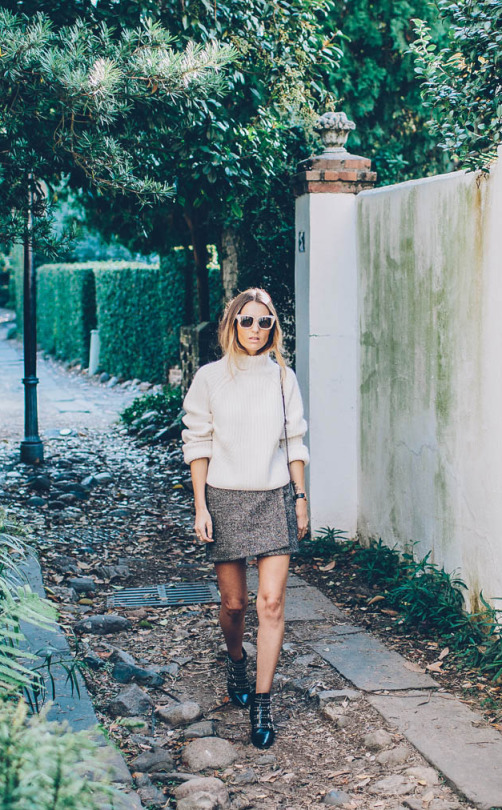 Jess Ann Kirby has created a cosy and authentic fall style by combining a knitted sweater and wrap around mini skirt. This look includes two of the hottest trends; knitwear and mini skirts!   Skirt: French Connection, Sweater: Revolve, Boots: Barneys.