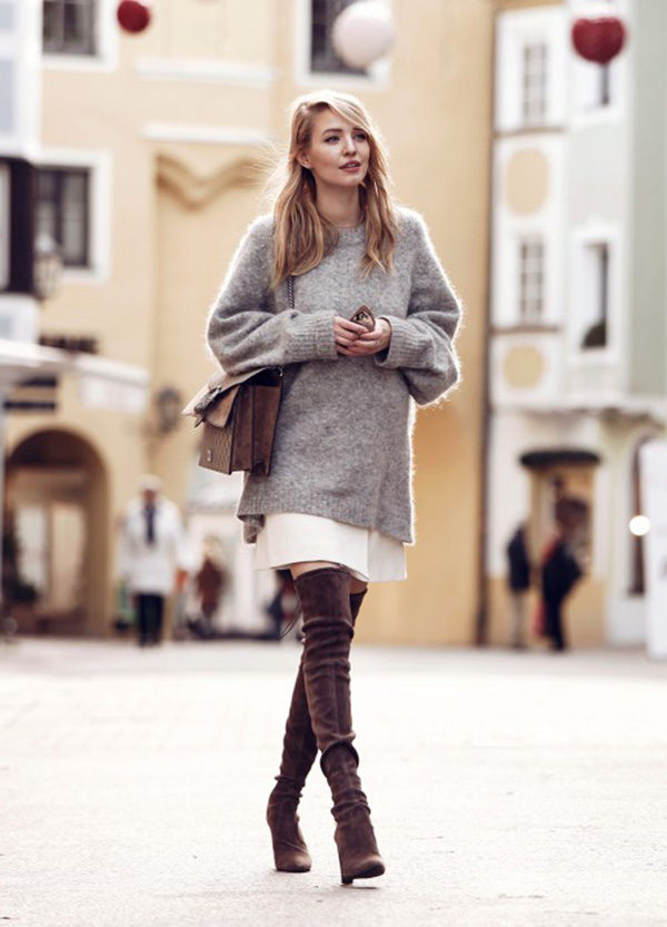 We're loving Leonie Sophie in her soft neutrals. This poised daytime look features an oversized heather grey sweater and over-the-knee boots to die for. Sweater: H&M, Skirt: Pinko, Boots: Stuart Weitzman, Bag: Gucci, Sunglasses: Jimmy Choo