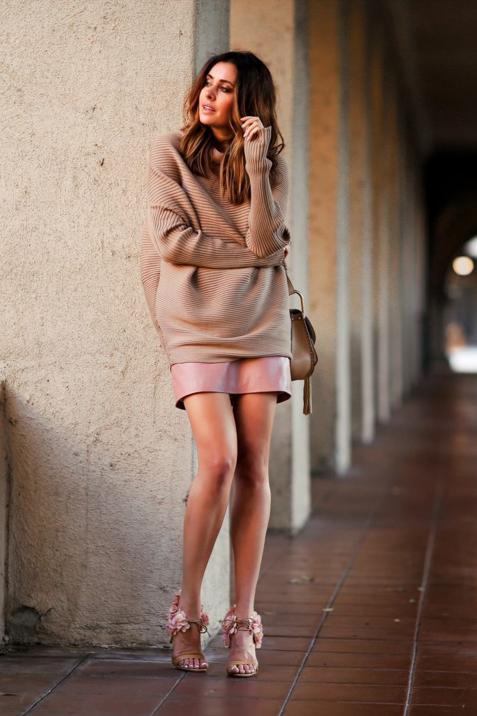 Erica Hoida is pretty in a pink leather skirt and petals on her heels. An oversized sweater and dewy makeup gives this style a dreamy, natural feel.  Sweater: Designer's Remix, Skirt: Topshop, Shoes: Rupert Sanderson, Bag: Chloe