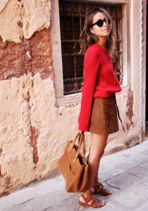 Julie Sarinana looks fresh and energetic in stoplight red and pottery brown. Her tie-up gladiator sandals are embellished perfectly to complement this daytime look. Sweater, Skirt, Bag and Sandals: Sezane