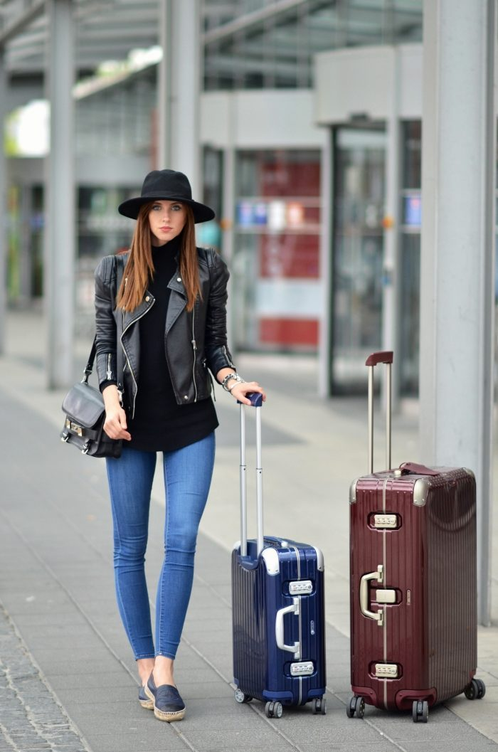 Looking chic with a structured leather jacket and handbag, Barbora Ondrackova dresses down her outfit with classic Chanel espadrilles. Rollneck: Proenza Schouler, Jeans: Topshop, Jacket: Zara, Espradilles: Chanel, Hat: Topshop, Bag: Proenza Schouler, Suitcase: Rimowa