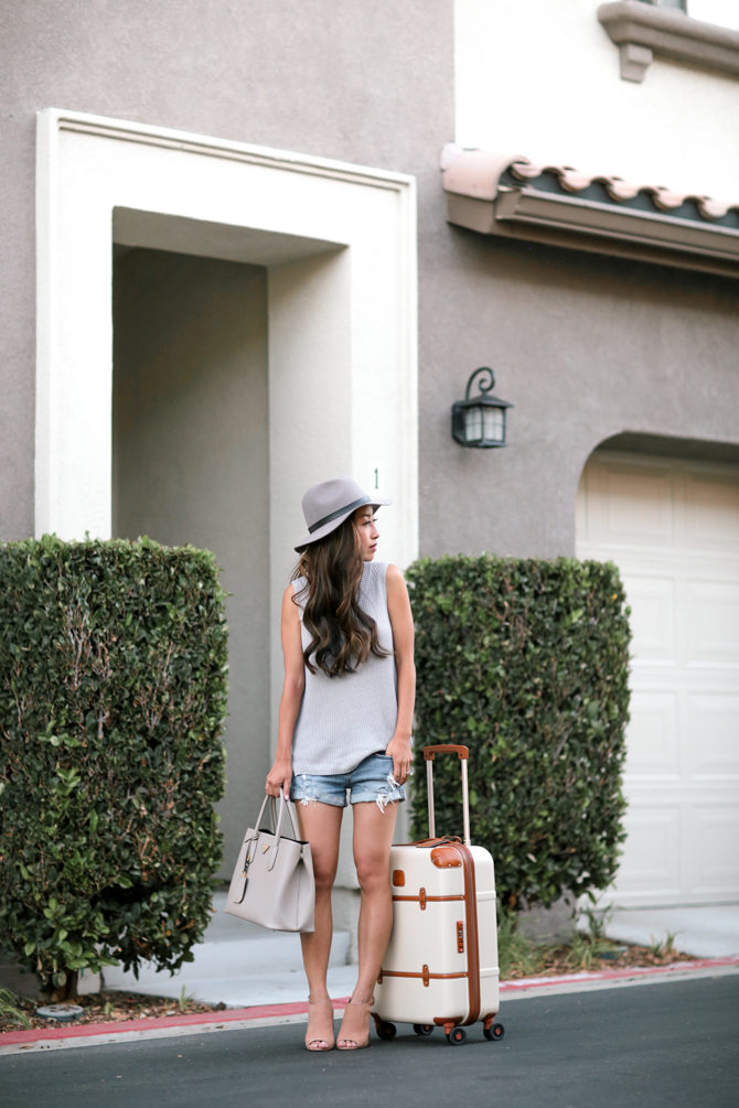 Head from the plane to the beach with Jean Wang's summery travel look. The nude sandals and hat is flawless, complemented perfectly with her statement bag. Hat: Sole Society, Shoes: Steve Madden, Sweater: BP, Suitcase: Brics