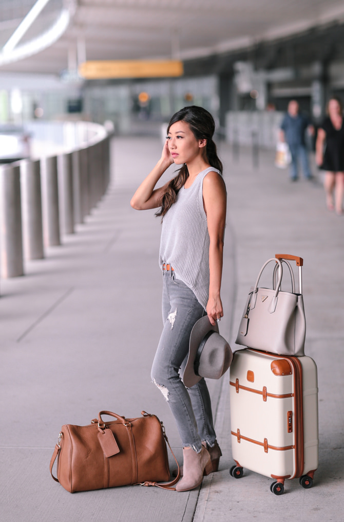 Jean Wang's neutral tones are classy, comfy and wrinkle free. We're also loving her coordinating luggage and blush low suede ankle boots.  Sweater: BP, Jeans: Express, Bag: Sole Society: Hat: Sole Society, Boots: Sole Society, Suitcase: Brics