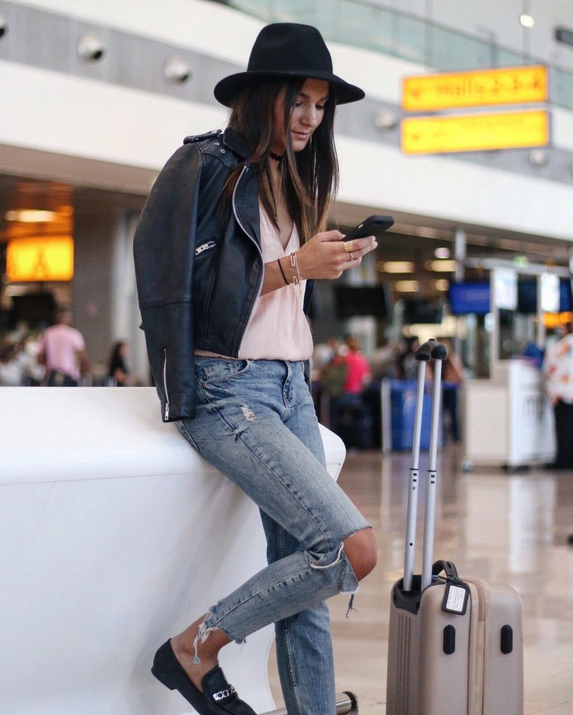 For a relaxed smart casual airport style, try pairing distressed jeans with a leather jacket and little black fedora. A hat will add endless authenticity to your look, and you'll undoubtedly be in fashion wherever you fly to! Via Federica L.