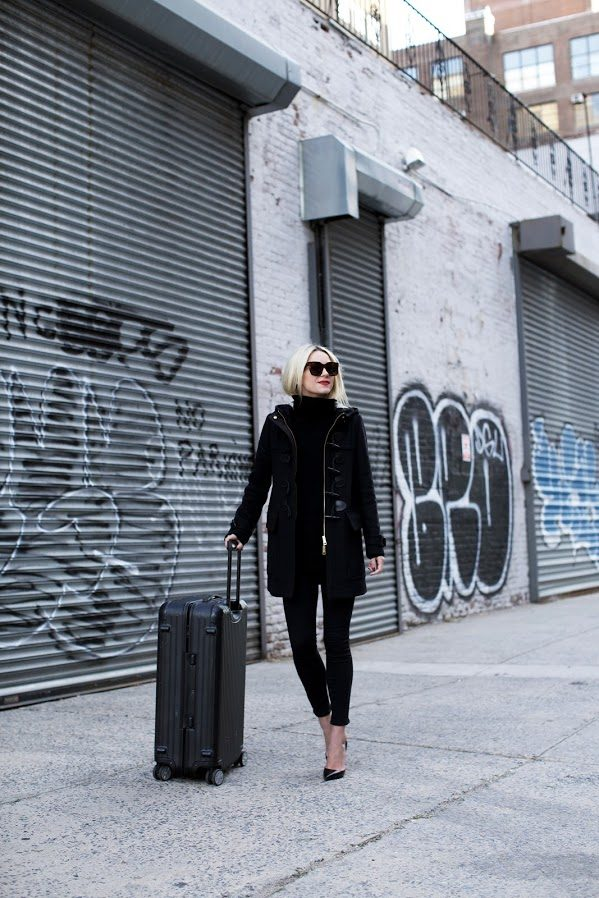 Elegant and classy, Blair Eadie's all black look is dressed up even more with heels and red lipsticks. Perfect for stepping off the plane and straight into a restaurant dinner reservation. Jacket: Burberry, Shoes: Christian Louboutin, Denim: Citizens of Humanity, Sunglasses: Celine, Luggage: Rimowa, Lips, Stila Beso