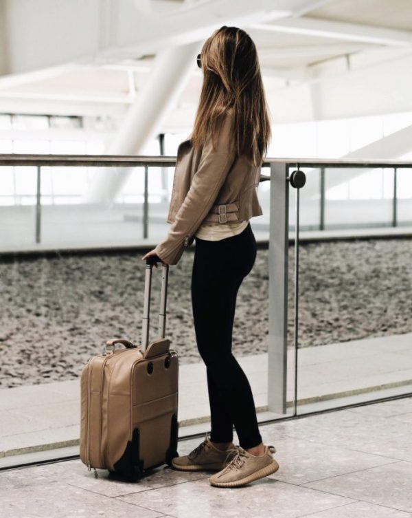 Marianna Hewitt goes for maximum comfort during travel– black leggings and designer trainers are a great option for still looking fashionable on the road.
