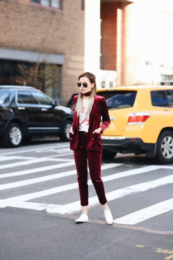 The velvet trend is smoking hot right now! Danielle Bernstein stuns us in this utterly gorgeous red velvet suit, worn with a white graphic tee and sneakers for a slick look which oozes boyish charm. Suit: Topshop, Sneakers: Karen Gallos.