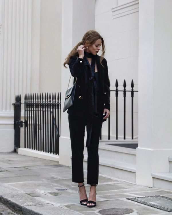 Nada Adelle is sleek, chic, and sophisticated in this gorgeous velvet suit, worn with stilettos and a silk skinny tie for an androgynous style we love! Keep it all black to add to the striking nature of this look. Blazer/Trousers/Shoes: Dorothy Perkins, Shoes: Saint Laurent.