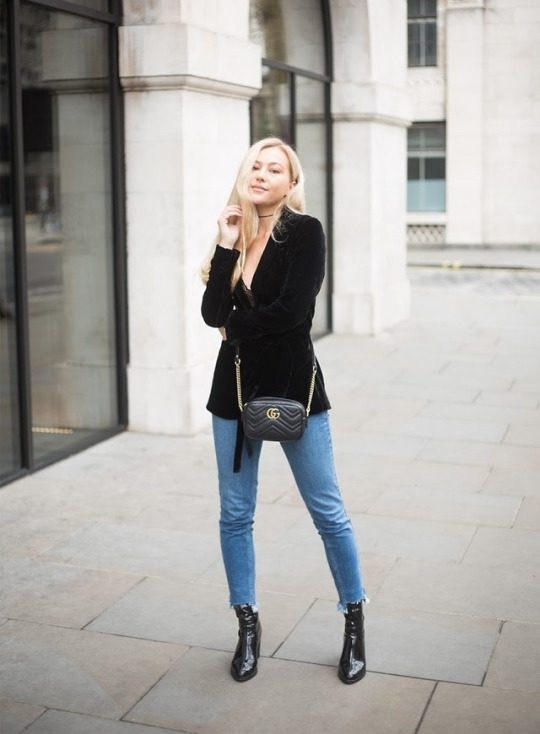 Hollie Hobin is keeping it casual in this trendy velvet cardigan, worn over a plunge neck top and paired with jeans for a smart street style. Wear a look such as this with leather boots to get a touch of that rocker girl edge.   Jacket: Zara, Top: Pretty Little Thing, Jeans: ASOS, Boots: Russell & Bromley.
