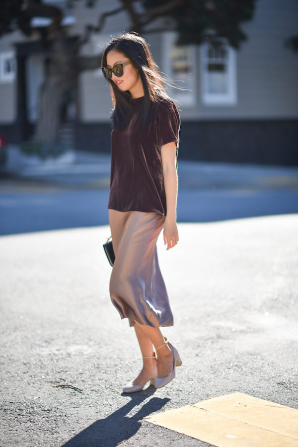 Ann Taylor is wearing yet another of the hottest trends; the velvet trend! By pairing this skirt with a velvet top, Ann has created a textured and stylish aesthetic which we adore. Top/Skirt: Vince, Pumps: Valentino, Purse: Marni.