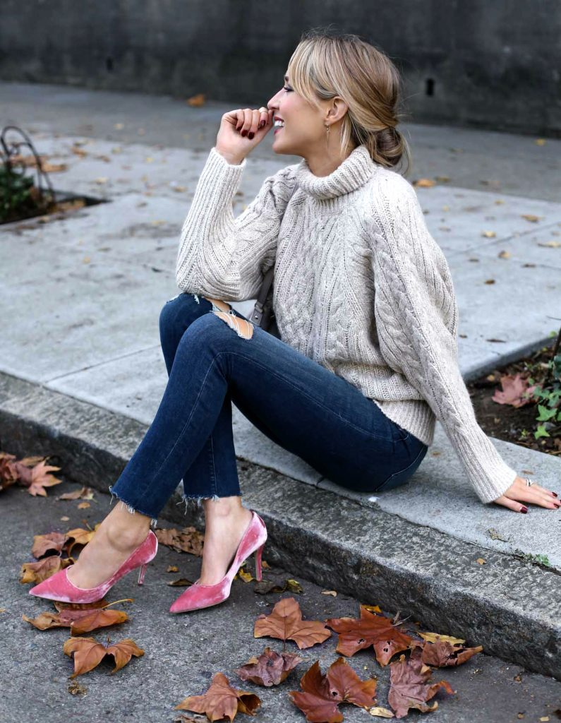 Mary Orton bucks the normal velvet trend by wearing it on her shoes! These pink velvet heels look gorgeous paired with distressed denim jeans and a cable knit sweater, but would also look great with a more formal style!   Sweater: Ralph Lauren, Jeans: J. Brand, Shoes: SJP Collection.