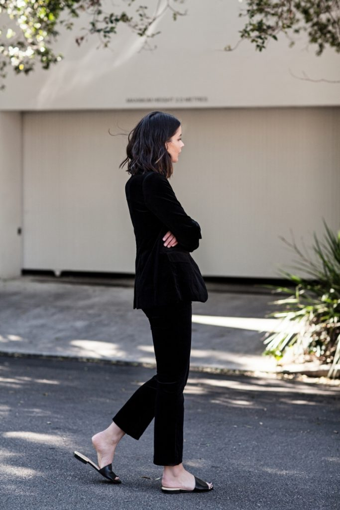 The velvet pantsuit is one way to make a statement. Sara Donaldson nails it by keeping her look monochrome and casual with leather sliders. For a dressy look, switch it up with black slingback stilettos.   Velvet Blazer and Pants: Black Frame