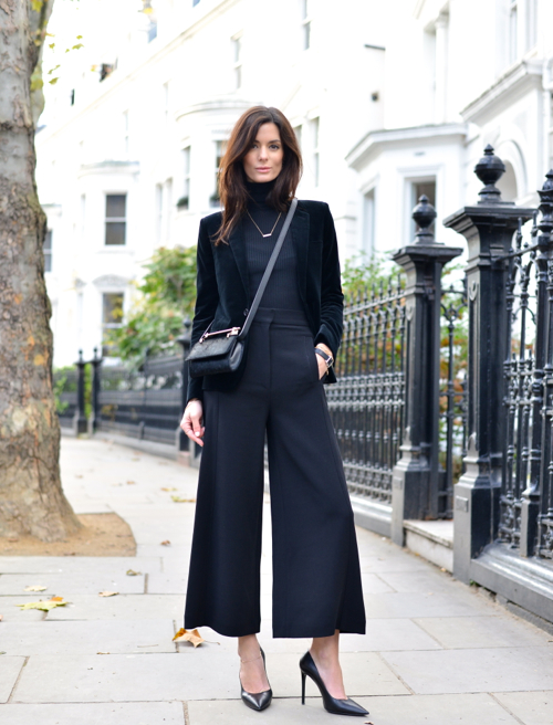 Hedvig Sagfjord Opshaug nails the culottes trend and finishes her sophisticated look with a velvet blazer and pointed heels. Her turtleneck makes this look cozy enough for fall.  Trousers: Proenza Schouler, Turtleneck: Gucci, Blazer: Saint Laurent, Shoes: Prada, Bag: M3Malletier, Watch: Isabel Marant, Necklace: Marte Frisnes, Earrings: Melissa Joy Manning