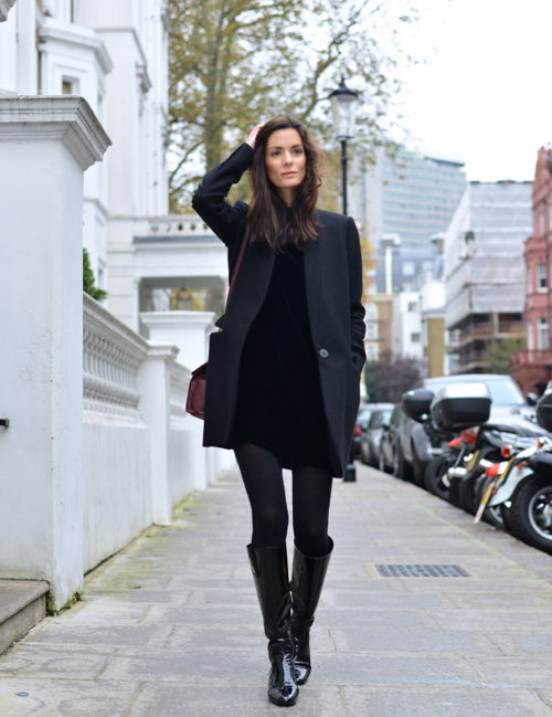 Hedvig Sagfjord Opshaug takes the little black dress into fall by adding tights, boots and a chic black coat. Dress: Cos, Boots: Saint Laurent, Coat: Stella McCartney, Tights: Falk, Bag: Balenciaga, Earrings: Annelise Michelson