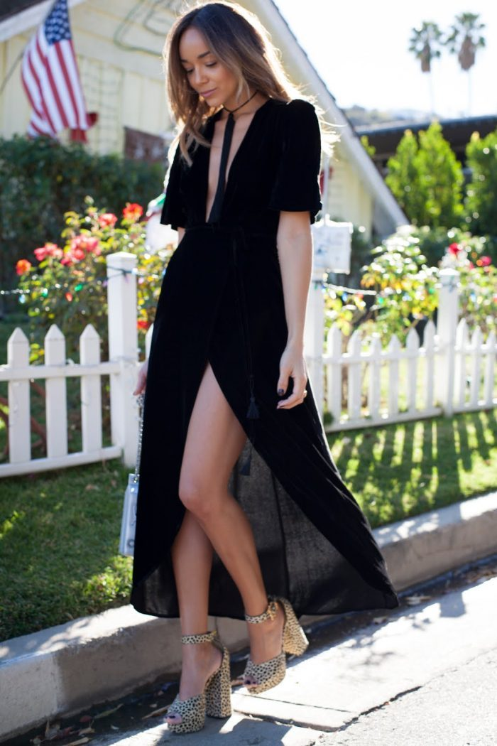 Ashley Madekwe looks like she just strutted of the runway in these amazing platforms, which she wears with a flowy dress for a romantic look. Dress: Reformation, Shoes: Charlotte Olympia, Choker, Saint Laurent, Bag: Chanel
