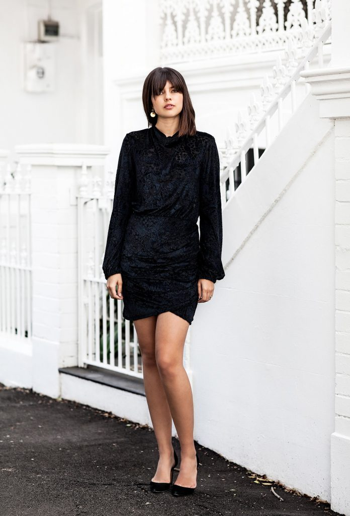 Talisa Sutton is effortlessly stylish in this textured black velvet mini dress. She adds gold earrings and black pumps for a feminine look. For a more casual look throw on a leather jacket.  Dress: Bec & Bridge, Earrings: Amber Sceats, Heels: Iro