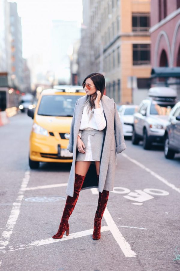 This outfit is the epitome of cool; Danielle Bernstein takes the velvet trend to the next level in these amazing knee high boots. She keeps the rest of her look simple and neutral so her boots do all the talking. These boots would also look great in spring with a little white dress. : Derek Lam Dress & Booties | Zara Coat