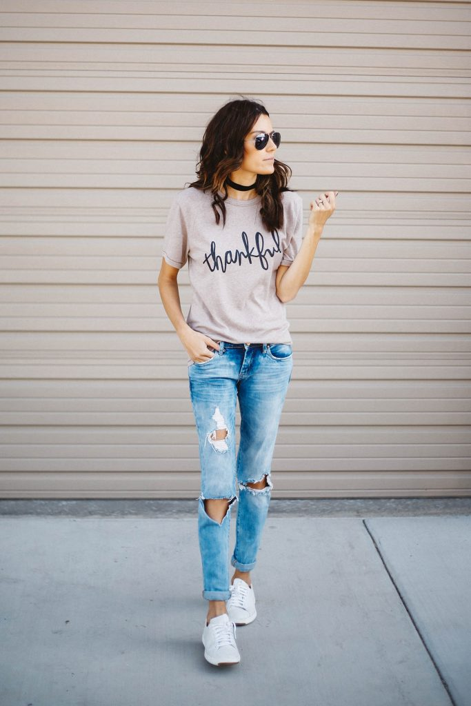 Chokers are a must-have for fall and winter! Simplistic yet chic, this look consists of a graphic print tee, jeans, and a pair of white sneakers. Via Christine Andrew.  Outfit: ILY Couture.