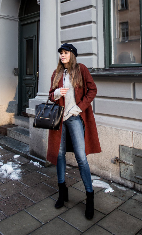 Kenza Zouiten has paired her choker with a simplistic fall style, consisting of a burgundy overcoat, knitted sweater, and denim jeans. Wear a look such as this with a choker to get this cool street style.   Outfit: Nelly.