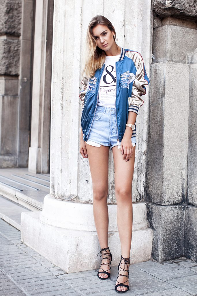 Nika Huk creates a fun, sexy take on the embroidery trend with this uber-cool satin bomber. She pairs denim cut-offs, a simple logo Tee and sexy black strappy sandals to finish the look. During the winter months, add a pair of ripped skinnies and heeled ankle boots to hero the jacket and keep warm.  Satin bomber: Shein, Tee: ASOS, Denim Cut-offs: Zara, Shoes: CMG, Watch: Marc Bale.