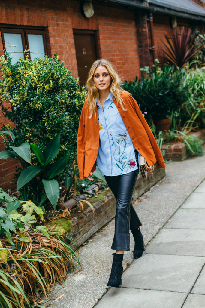 Olivia Palermo has blended casual with a sophisticated edge that heroes her poplin embroidered shirt.  Her cropped leather flares, brocade booties and suede overshirt, give this look a distinct edge to this season's trends.  Cropped Leather Flares: Palermo x Chelsea 28, Floral embroidered poplin shirt: Zara, suede shirt: Tibi, Crystal heel booties: Sophia Webster, Pierce bag: J.W. Anderson.