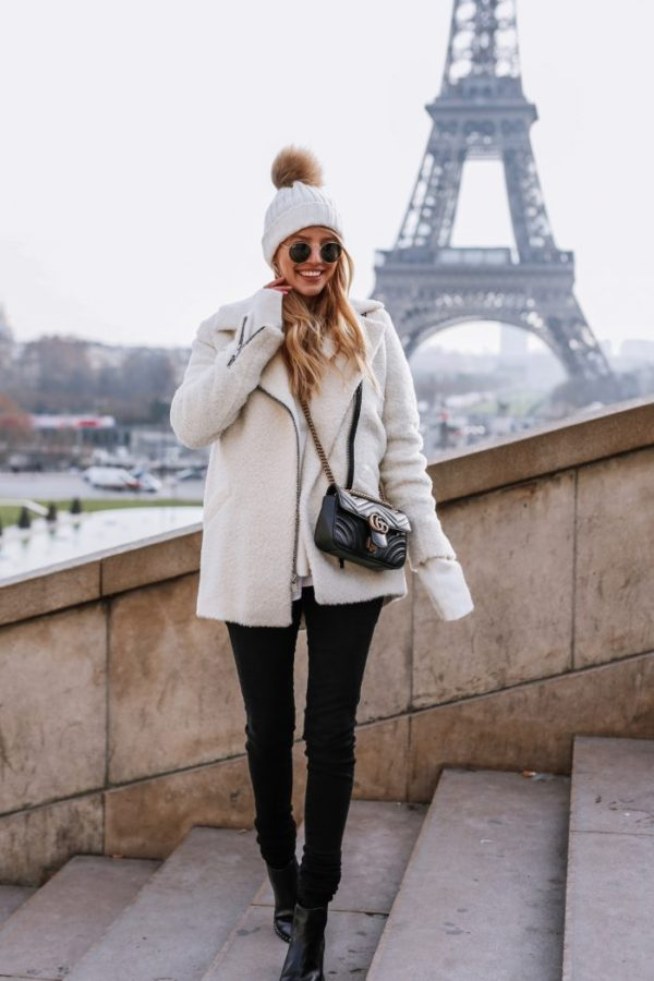Leonie Sophie is ready for winter in every sense in this gorgeous outfit,  pairing a cream faux sheepskin coat with skinny black jeans and a bobble  hat for