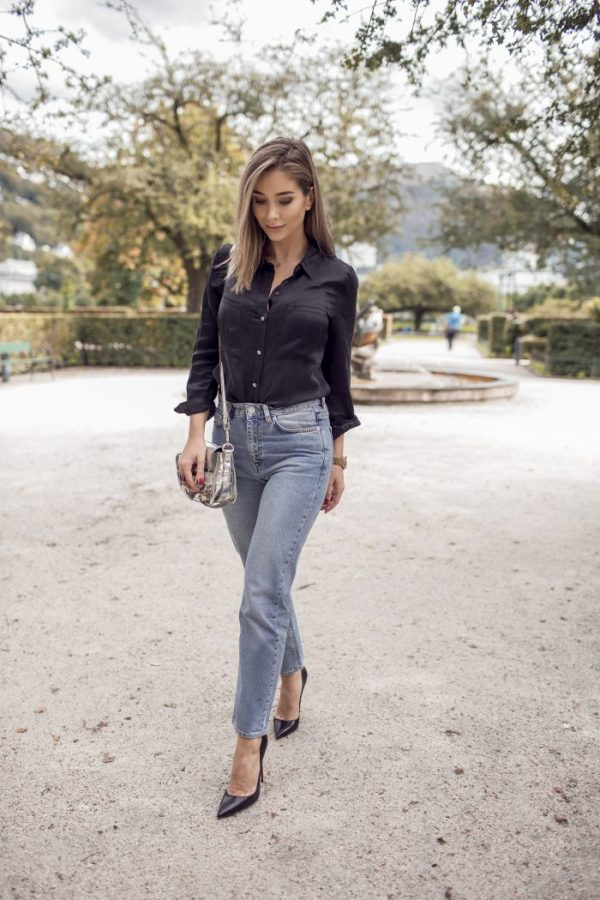High waisted jeans aren't going anywhere. Emilie Tommerberg is seen wearing her faded version with a classic black shirt. Perfect for a coffee date or dress down Friday. Shoes: Christian Louboutin, Jeans: Wood Wood