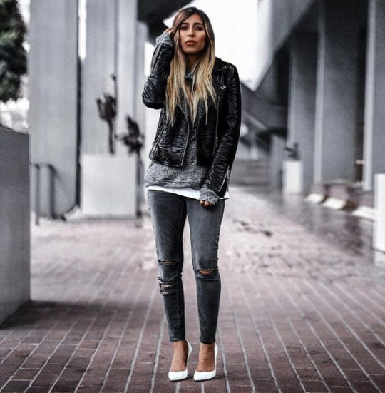 Aditi Oberoi Malhotra is wearing a leather jacket with black jeans, distressed at the knee, a grey top, and white stiletto heels. Shoes: Gianvito Rossi.