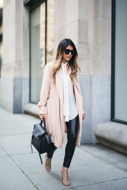 Pam Hetlinger is wearing a slouchy pastel cardigan sweater, basic faux leather leggings, a white blouse with necktie and strappy nude heels. Coat: Mango, Blouse: Leggings: Heels: Schutz