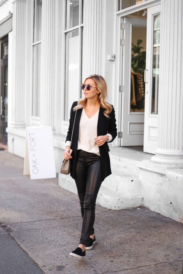 Laurie Ferraro is wearing a cream cashmere knit v-neck top, a black blazer, black leather pants, black flats and carrying a nude crossbody bag. Cluse Silver Watch here ElleSD Leather Pants: ElleSD: Blazer: LXE, Top: Halogen, Sunglasses: Sunday Somewhere, Shoes: Ariagato