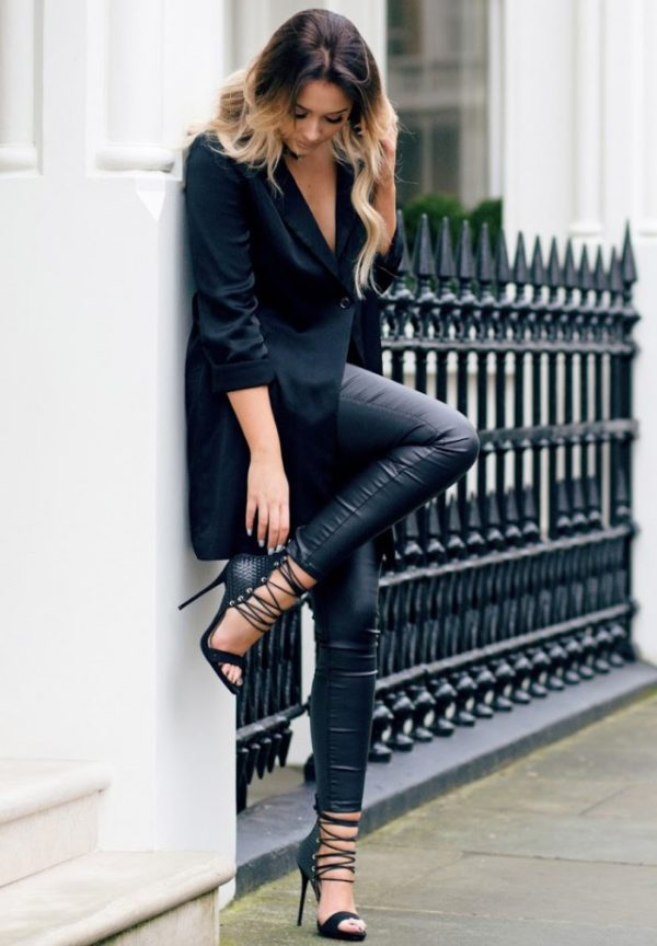 Sarah Ashcroft is wearing a long black blazer, leather jeggings and lace up black leather stilettos. Blazer: H&M, Choker: H&M, Heels: Simmi, Pants: Missguided