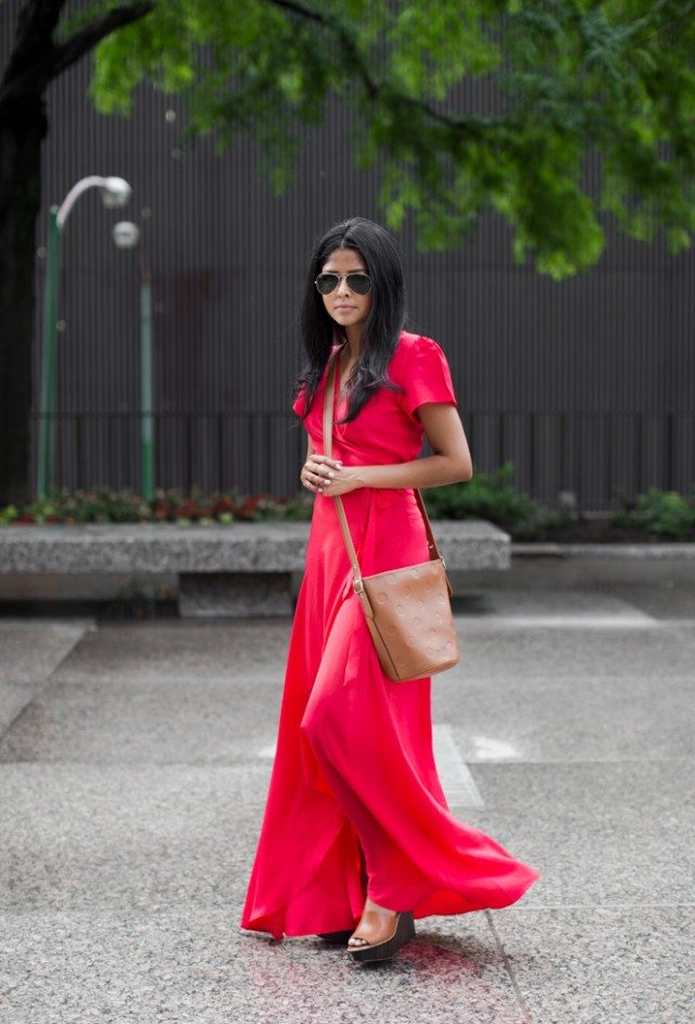 Make a statement in a scarlet maxi dress like Sheryl Luke! We absolutely adore this elegant and sexy wrap dress, and paired with simple neutral wedges and a matching leather bag it is the perfect evening look! Dress: Helena Quinn, Bag/ Shoes: Coach.