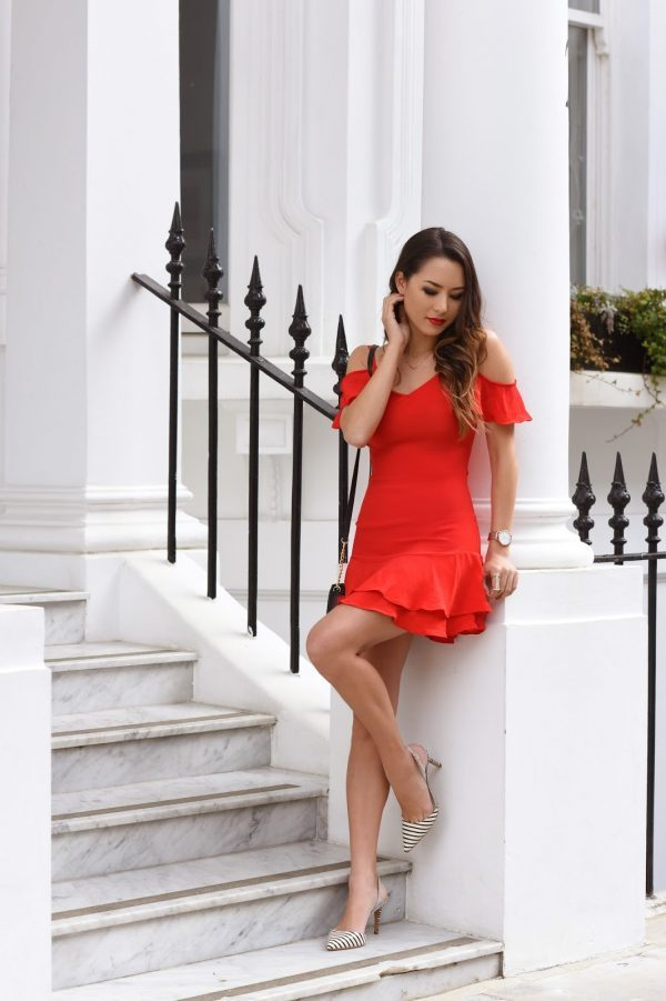 Jessica R. is looking ultra sexy in this playful red mini dress, with ruffle sleeve and skirt detailing. Pair this style of dress with statement heels like these striped stilettos to steal Jessica's look! Dress: Lulus.
