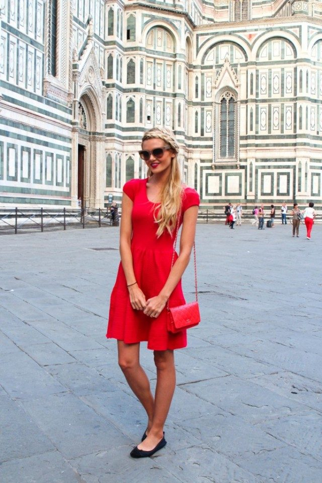 A red t-shirt dress is another awesome way to wear the red dress trend this summer! We love this simple but stylish outfit, matched with ballet pumps and sunglasses. Via Amber Fillerup Clark. Dress: Small shop in Florence, Sunglasses: Prada, Bag: Chanel via Fashionphile, Shoes: Yosi Samra.