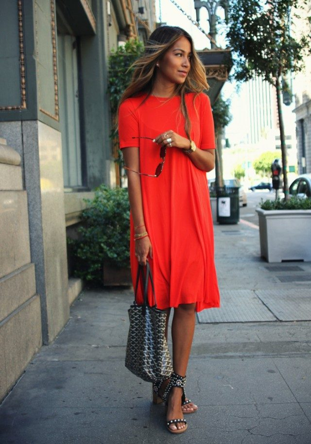 This simple red t-shirt dress makes the perfect summer outfit worn with studded sandals and a statement bag by Julie Sarinana. We love this look! Dress: COS, Shades: Raen, Heels: Isabel Marant.