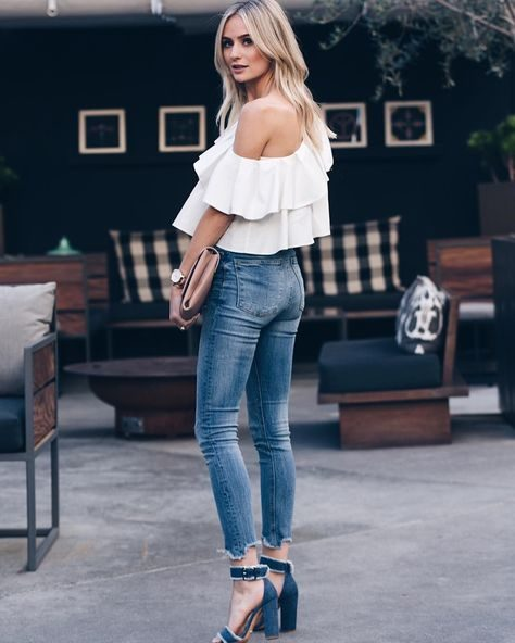 Lauren Bushnell is seen in chunky blue suede heels, with buckle detailing and white outline. She pairs these with skinny, faded denim jeans, and an off the shoulder floaty white top, the perfect spring style! Top: Melissa Buaitellier, Jeans: Zara.