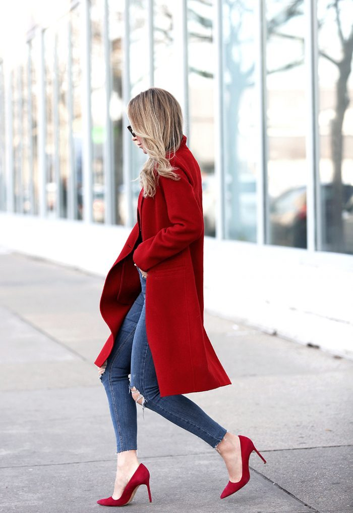 Helena Glazer is wearing a tailored red coat, cropped destroyed knee skinny jeans and red pointed toe pumps. Coat: Vince, Denim: Topshop, Bodysuit: Only Hearts, Shoes: Manolo Blahnik, Sunglasses: Fendi