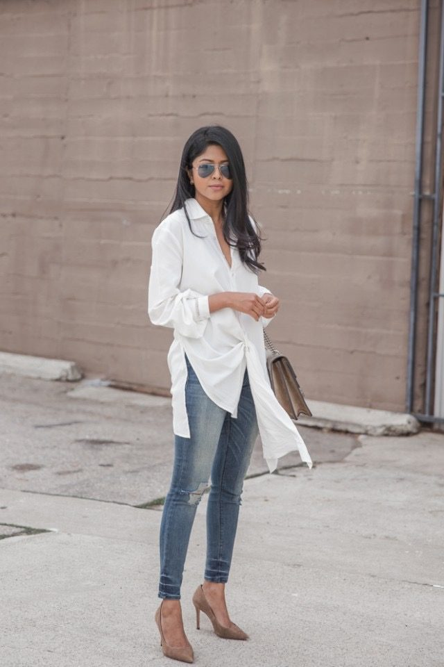 Sheryl Luke is wearing a draped white poplin button up shirt, lightly distressed skinny jeans and taupe pointed stiletto heels. Top: StyleStalker, Jeans: Black Orchid Denim, Shoes: Coach