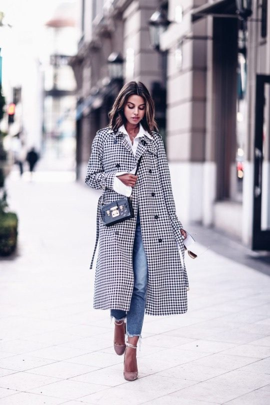 Annabelle Fleur is wearing a black and white checked trench coat, a white collared shirt, cropped frayed jeans and pink velvet pumps with an ankle strap. Coat: Sonia Rykiel, Shirt: Iorane, Pumps: Aquazzura, Jeans: 3X1, Bag: Louis Vuitton, Sunglasses: Dita.