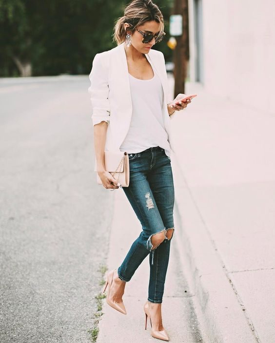 af7ea6934d Christine Andrew combines ripped denim jeans with a white cami and blazer  to create a smart