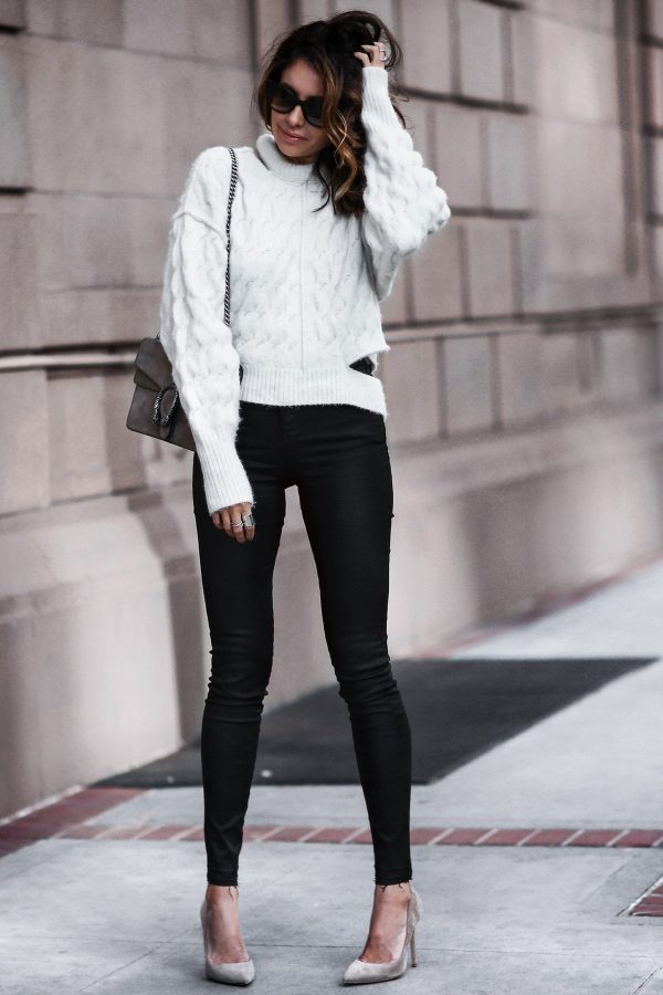 Erica Hoida is wearing a white cable knit sweater with black skinny jeans, nude suede pumps and a leather shoulder bag. Sweater: Topshop Unique, Jeans: Topshop, Shoes: Gianvito Rossi, Bag: Gucci