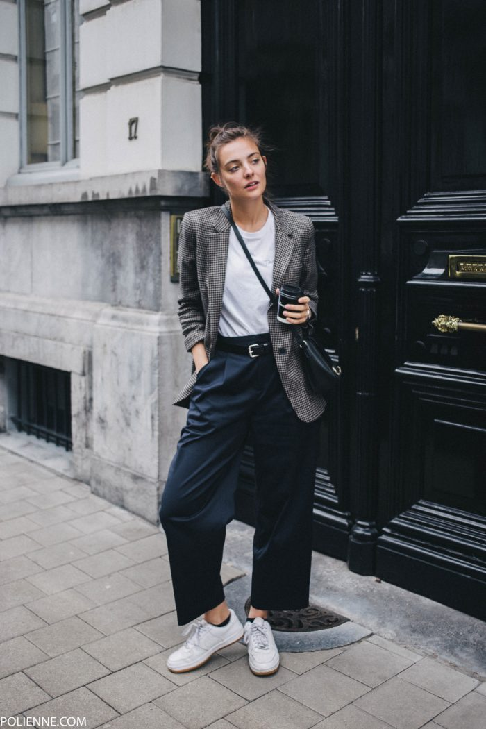 Paulien Riemis oozes boyish charm here, pairing a white tee with a tweed blazer and high waisted navy wide-leg trousers, finishing the look off with sneakers. Coat: Mango, Blazer: Zara, Trousers: Weekday, Bag: Pull & Bear.