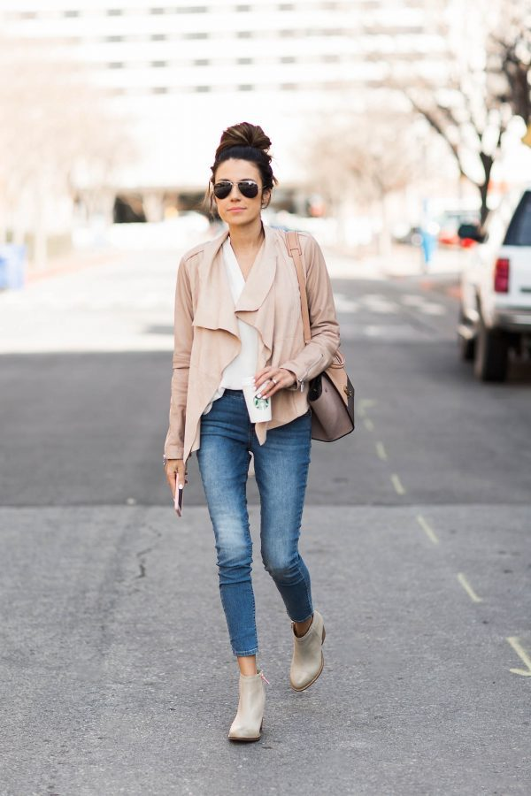 Christine Andrew is wearing a blush pink suede jacket, a relaxed white top, cropped skinny jeans and nude leather ankle boots. Top: Ily, Jacket: Bernardo, Jeans: Old Navy, Boots: Hushpuppies, Sunglasses: Ily, Bag: Céline