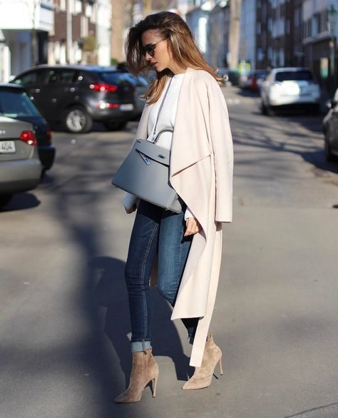"Alexandra Lapp is seen here in a gorgeous oversized wrap coat, worn over rolled denim jeans and a light blue sweater. She pairs this with suede spike-heeled boots. Jeans: Rag & Bone, Shoes"" Gianvito Rossi."